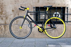 Cool black and yellow bike. Locked royalty free stock images