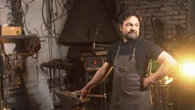 Cool blacksmith portrait with beard in workshop.  Stock Images