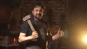 Cool blacksmith portrait with beard in workshop Royalty Free Stock Image