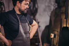 Blacksmith portrait with beard in workshop Stock Photo