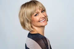 Cool blonde fashion lady. Flashing a warm smile Stock Photos