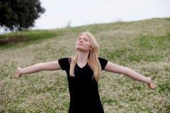 Cool blonde girl enjoying of good time at spring Stock Photos