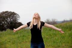 Cool blonde girl enjoying of good time at spring. Blonde girl enjoying of good time at spring stock images