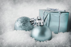 Cool Blue Christmas Decorations in Snow Stock Photo