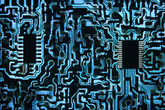 Cool Blue Information Highway. Backlit Cool Blue Circuit with Chips Stock Images