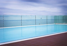 Cool blue inviting swimming pool Stock Photos