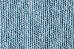 Cool blue knitting. Close up of knitting meshes light blue and white mixed Royalty Free Stock Photography
