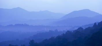 Cool Blue Landscape. Cool morning mist of Bukit Tabur, Kuala Lumpur, Malaysia Stock Photo