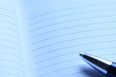 Cool blue notebook with pen Royalty Free Stock Images