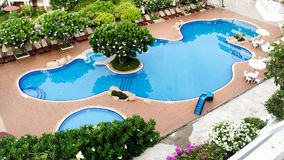 Cool blue summer holiday pool Royalty Free Stock Image