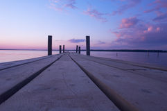 Cool Blue Sunset. A lakeside dock at sunset Stock Photos