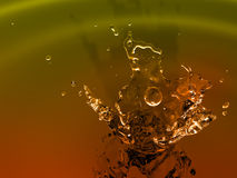 Cool bourbon splash. On calm blue wave background stock photos