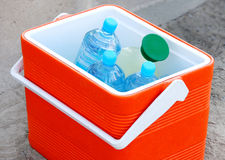 Cool box containing water bottles and juice Stock Images
