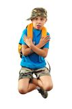 Cool boy with backpack and a cap jumping Stock Images