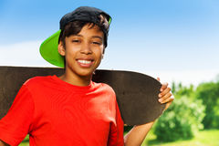 Cool boy in cap and with skateboard portrait Stock Photos