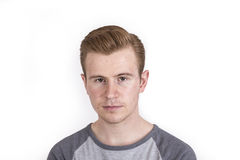 Cool boy with cool facial expression  poses in studio Royalty Free Stock Photo