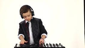 Cool boy dj in headphones playing on vinyl. Slow motion stock footage