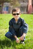 Cool boy on a grass field Royalty Free Stock Photos