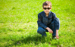 Cool boy on a grass field Royalty Free Stock Image