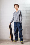 Cool Boy and his skateboard Royalty Free Stock Photo