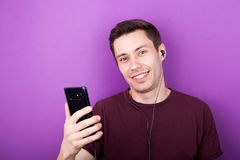 Cool boy listening to music on smartphone Royalty Free Stock Photography