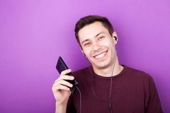 Cool boy listening to music on smartphone Royalty Free Stock Photo