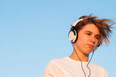 Cool Boy Listening to Music Stock Photography
