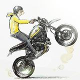 Cool boy riding extreme motorcycle Stock Image