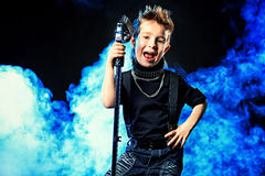 Cool boy singing Stock Photography
