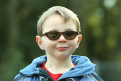 Cool boy with sun glasses. Outdoors Stock Images
