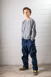 Cool Boy. A Teenage boy, standing, hands in his pocket, making a cool confident face and pose Stock Photos