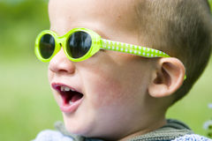 Cool boy yelling. Young toddler wearing bright yellow sunglasses Stock Photos