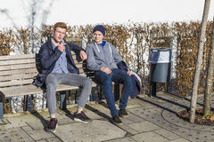 Cool boys sitting on a bench Stock Photo