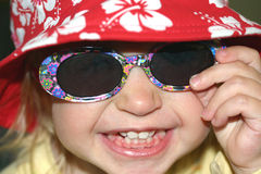 Cool brat!. Toddler with sunhat and glasses Stock Photos
