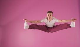 Cool break dancer mid air doing the splits. In the dance studio Royalty Free Stock Photo