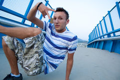 Cool breakdancer on bridge Stock Images