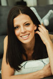 Cool brunette girl sitting on the sofa Royalty Free Stock Photos