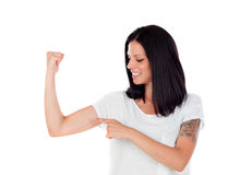 Cool brunette woman pointing her biceps Stock Photography