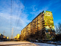 Cool building. Building, with graffiti on his side, snow on the ground, electricity wires and blue sky on a suburb in Saint Petersburg, Russia Royalty Free Stock Photography