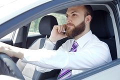Cool business man on the phone in car Royalty Free Stock Image