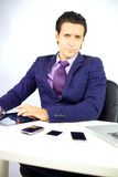 Cool business man working with tablet in office Stock Image