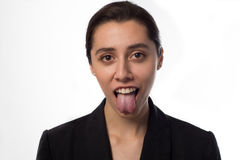 Cool business woman showing tongue.  royalty free stock images