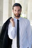 Cool businessman with beard and black tie Royalty Free Stock Photo