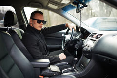 Cool businessman behind  wheel of your car. Cool businessman behind the wheel of your car Royalty Free Stock Photography