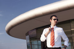 Cool businessman in front of office building. Stock Image