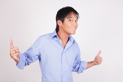 Cool businessman gesturing and smiling Stock Photos