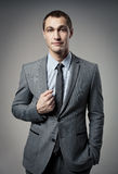 Cool businessman portrait on grey Stock Photo