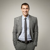 Cool businessman portrait on grey background Royalty Free Stock Photography