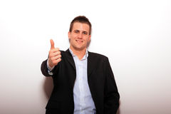 Cool businessman standing Royalty Free Stock Image