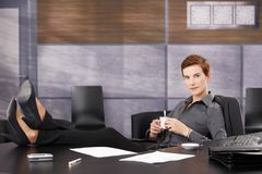 Cool businesswoman on coffee break Royalty Free Stock Images